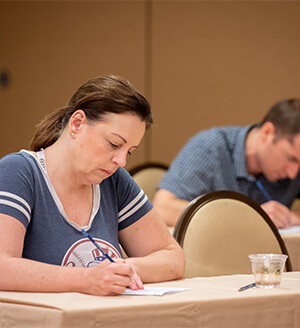 A photo of individuals getting ready to take the official Mensa Admission Test at the 2019 Annual Gathering.