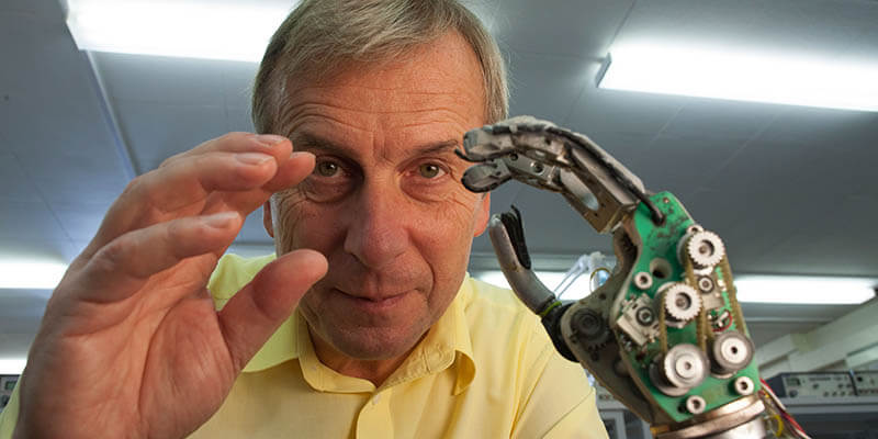 Kevin Warwick, British engineer and cybernetics expert displays his robotic hand.