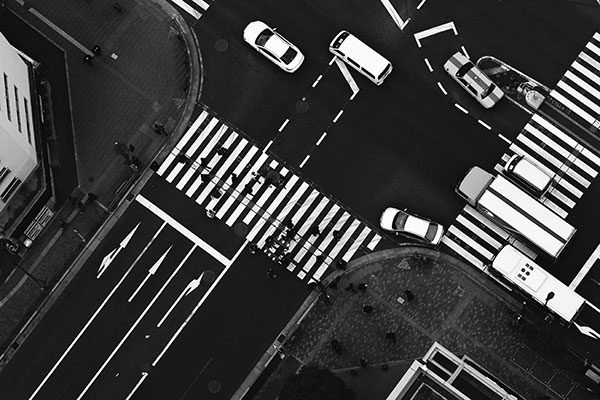 A black-and-white, overhead photo of a busy intersection