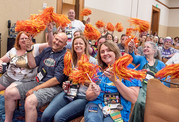 Members of American Mensa Special Interest Groups display their team spirit during a group competition at Annual Gathering 2018 for bragging rights