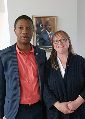 A photograph of Phil Dixon and Jane Allen meeting at the Embassy of Liberia in London