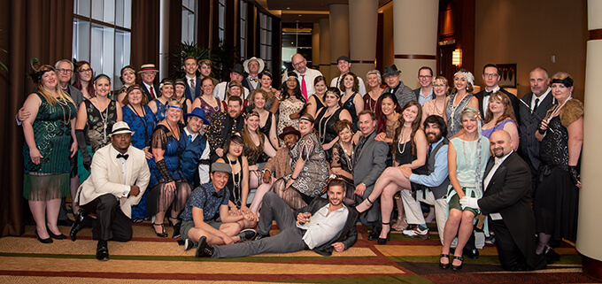 Members of the the GenY SIG pose for a photo before their Roaring '20s themed soirée at the 2019 Annual Gathering.